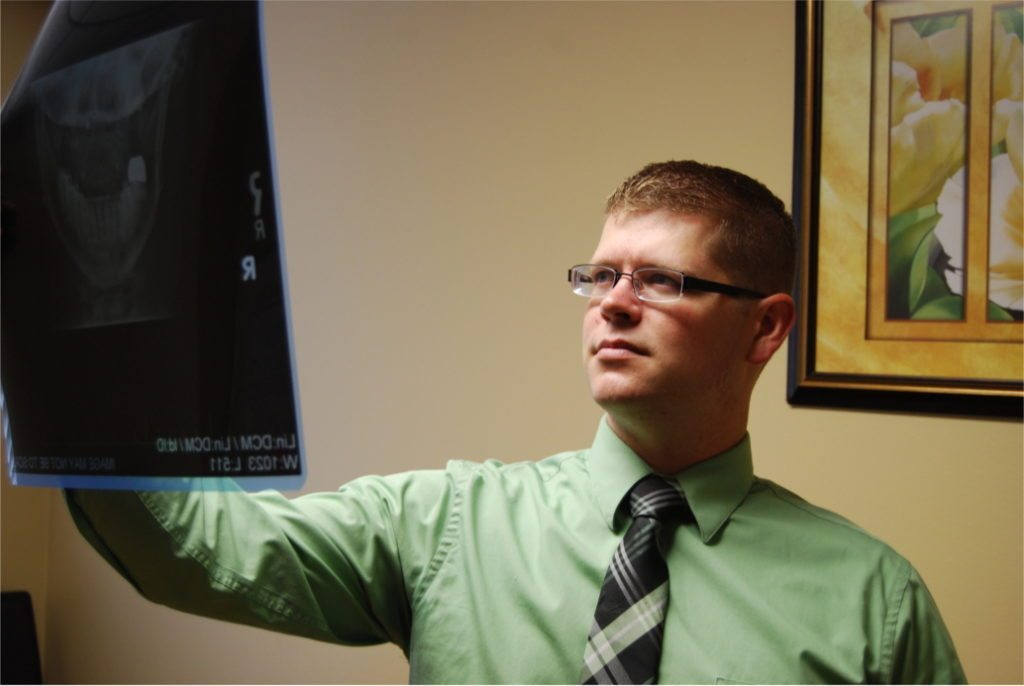 Dr. Reece Hayden reviewing a cervical (neck) x-ray at Synergy Chiropractic of Houston