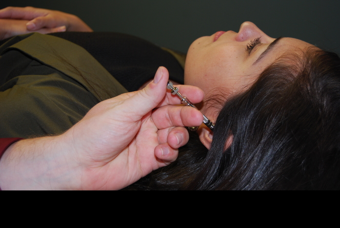 Dr. Reece Hayden Performs Acupuncture for Pain Relief
