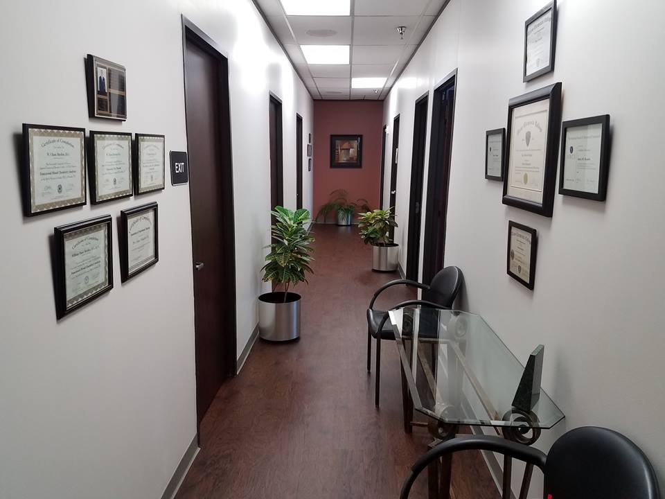 From the entry, the main hallway leads to the various treatment rooms, including Pam's massage room, the rehabilitation room, and two treatment rooms.